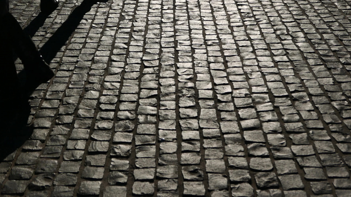 Cobblestoned street at night
