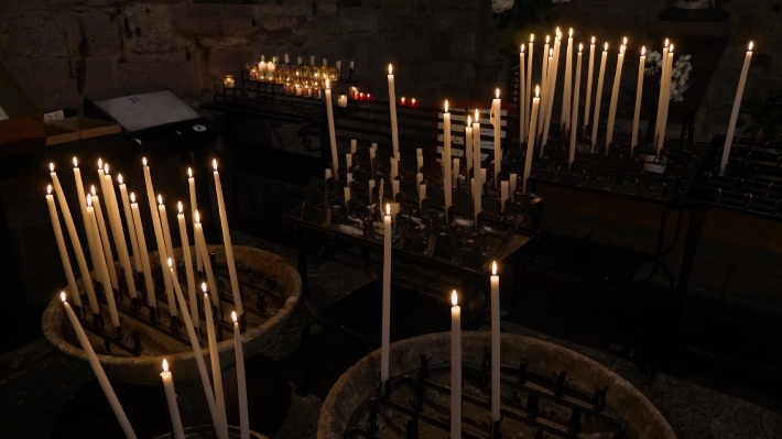 Offering candles in a church on the French Camino.