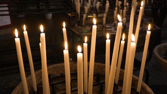 Offering candles in chiurch France