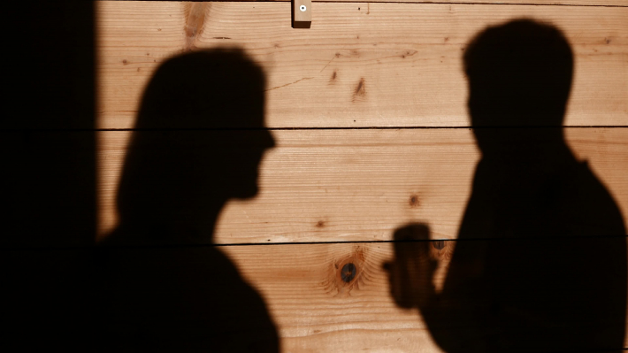 Shadows of a woman and a men talking
