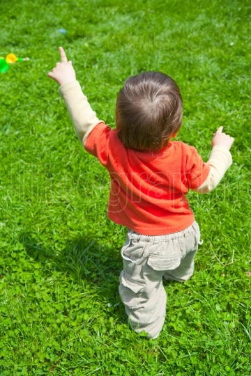 Baby walking in grass