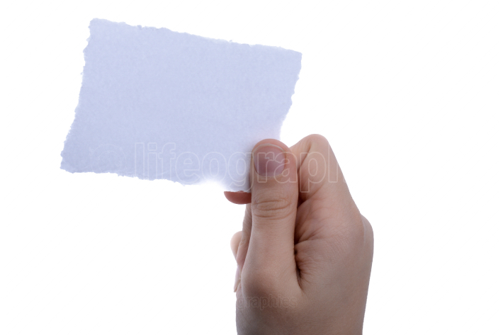 blank torn notepaper in hand