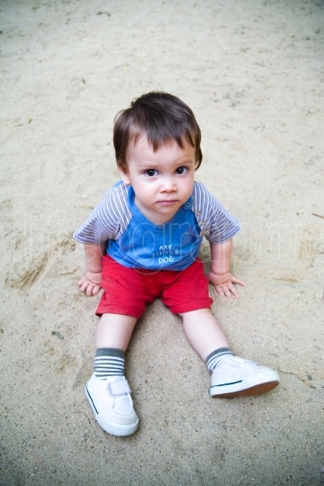 Child sitting in sand