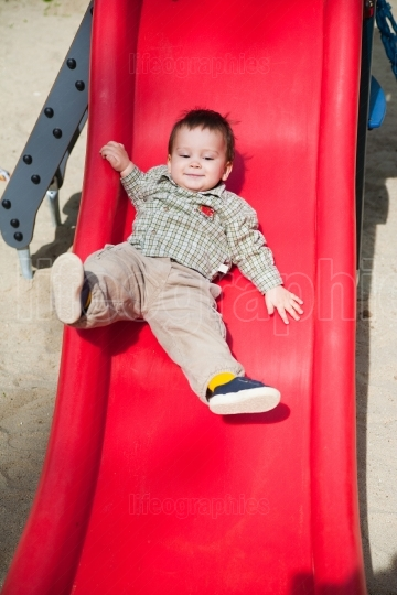 Cute child on slide
