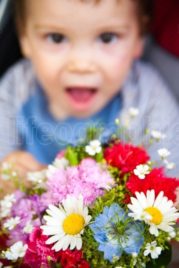 Funny baby with flowers