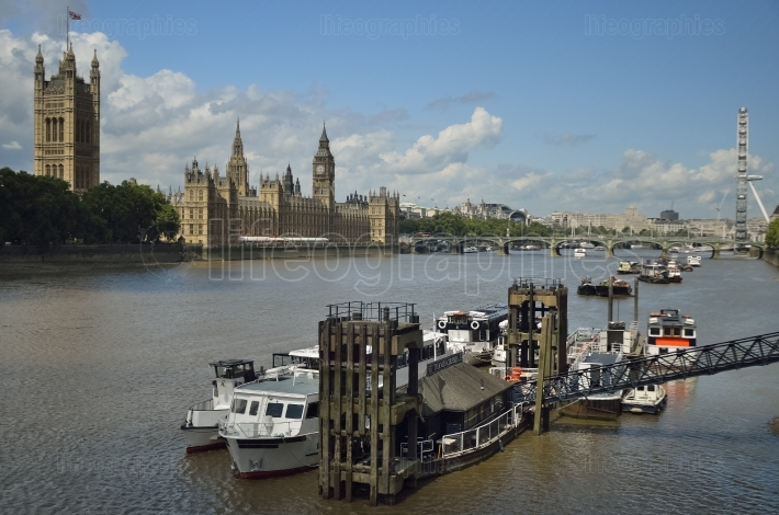 Houses of parliament, local pier for boats, big ben, and thames river.