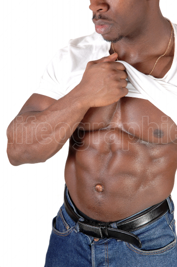 A black African bodybuilding man is showing his chest