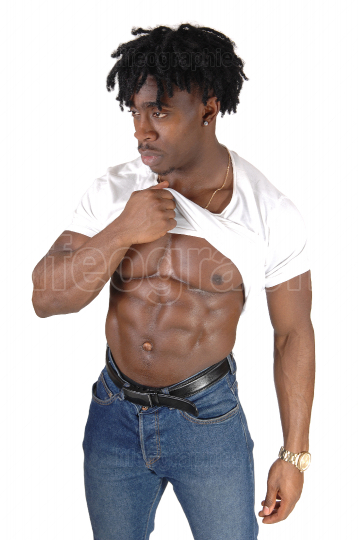 A black bodybuilding man shows his chest