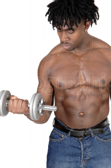 A black man working out with dumbbell