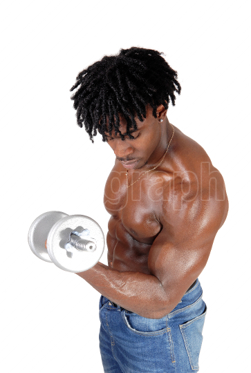 A black man working out with his dumbbells