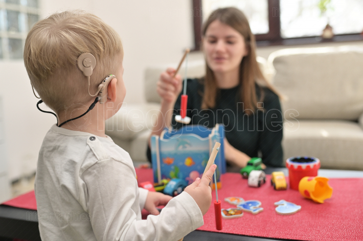A Boy With Cochlear Implants Playing