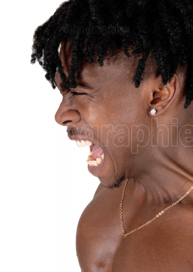 A close up image of a screaming black man in profile