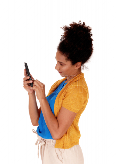 A close up image of a young woman dialling at her phone