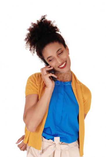 A close up image of a young woman talking at her phone