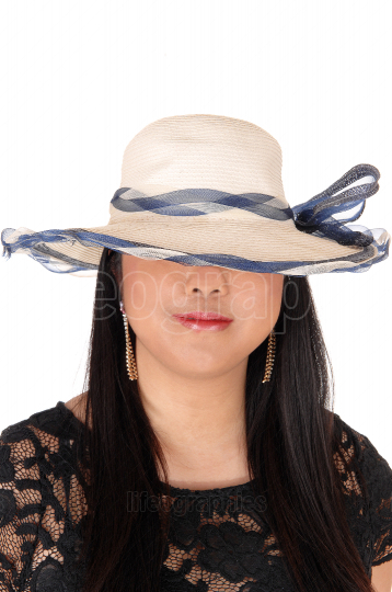 A close up portrait of a Chinese woman with a summer hat