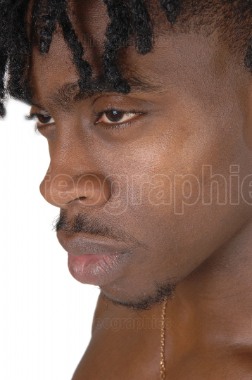 A close up portrait of the face of a black man without an shirt
