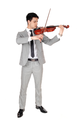 A full body image of young man playing the violin