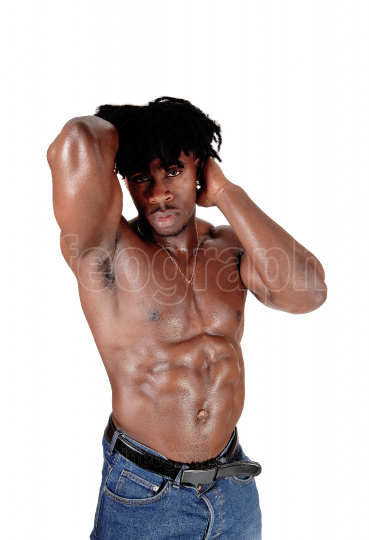 A handsome African man standing topless