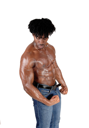 A handsome African man standing topless flexing his muscle
