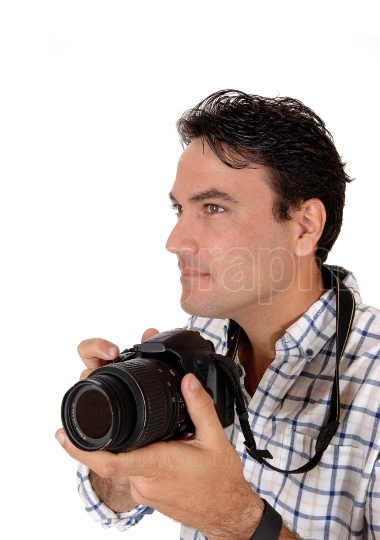 A handsome man holding his camera ready for a shoot