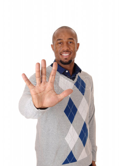 A happy African man holding his hands up, saying no