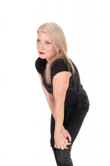 A happy looking blond woman standing in black outfit