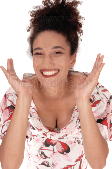 A happy multi racial woman in a summer dress in close up