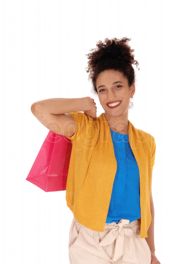 A happy multi racial woman with her shopping bag