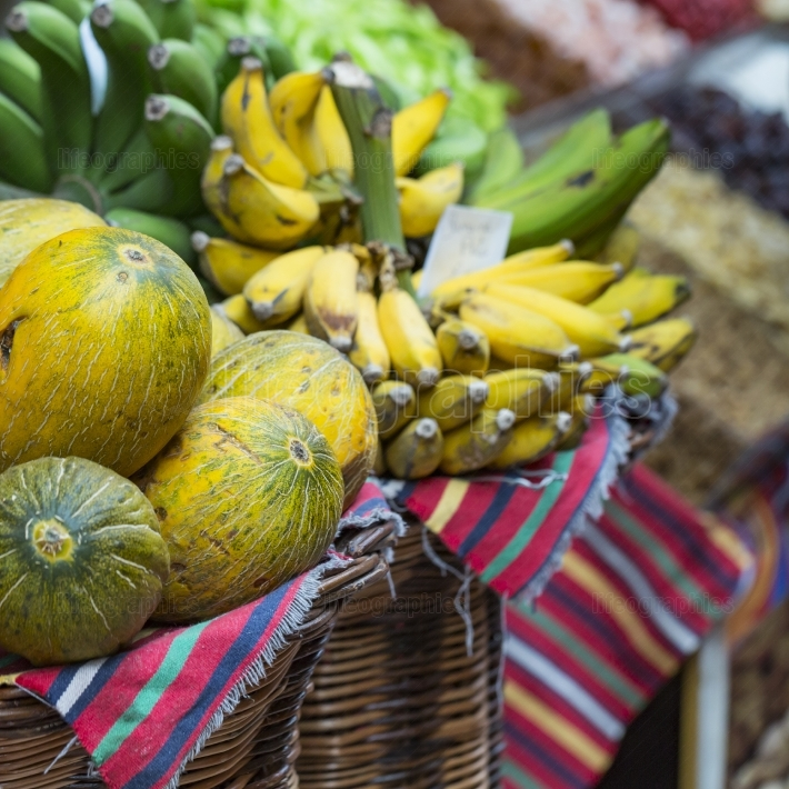 A lot of tropical fruits in outdoor market