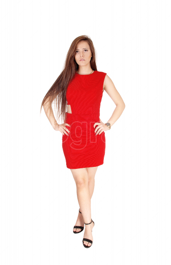 A lovely young woman standing from the front in a red dress