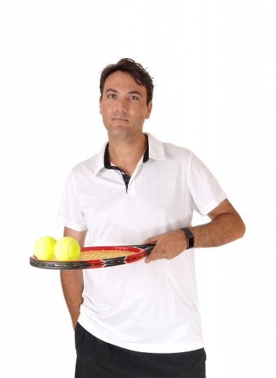 A man tennis player holding the racket and balls