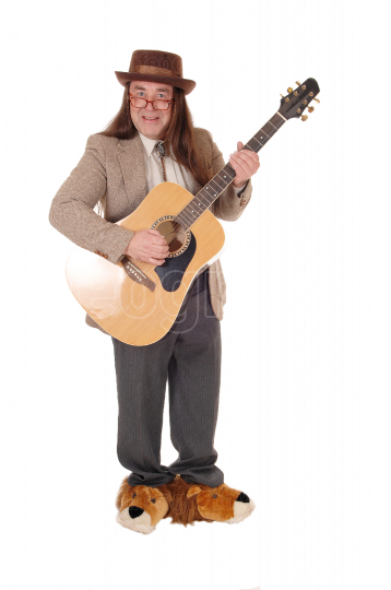 A musician playing the guitar standing in the studio