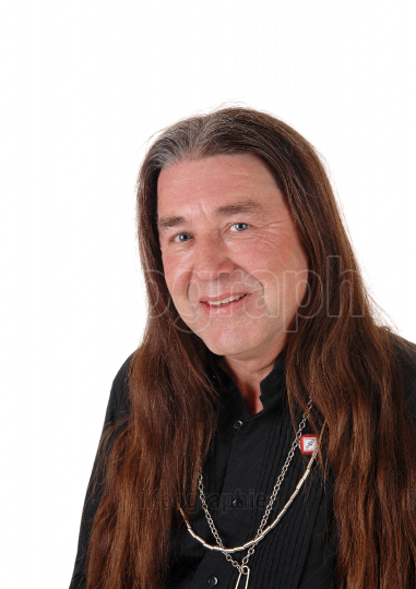 A portrait image of a indigenous man with long hair