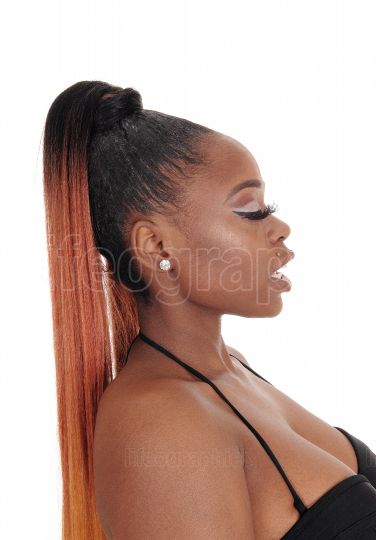 A profile portrait of a beautiful African woman