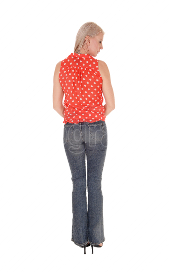 A slim middle age woman standing from the back