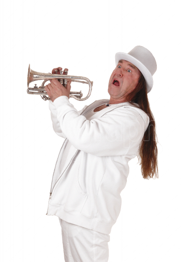 A trumpet player standing in a white outfit and hat and screamin