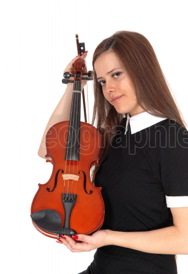 A woman standing and holding her violin to show