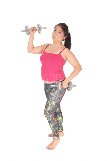 A young Asian woman exercising with two dumbbells