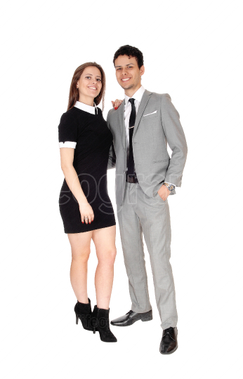 A young beautiful couple standing smiling in the studio