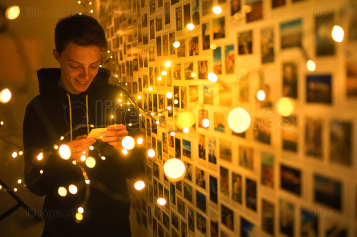 A Young man In Lights and Memories Photos
