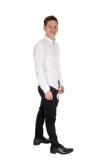 A young teenager boy standing in a white shirt