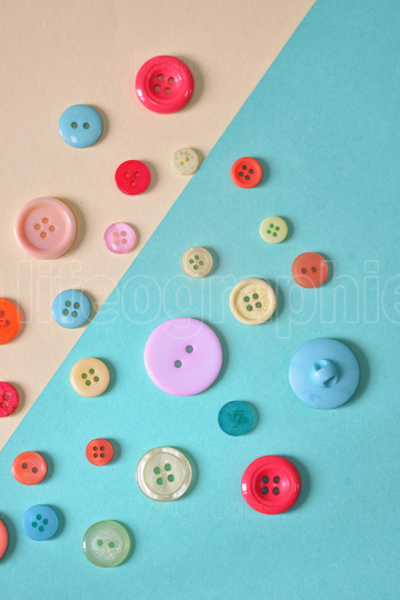 Abstract colored paper and buttons