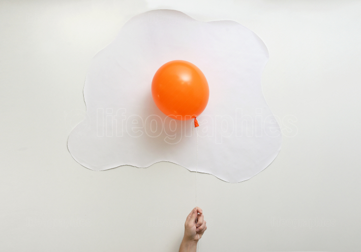 Abstract Orange Balloon In Shape Of An Fried Egg