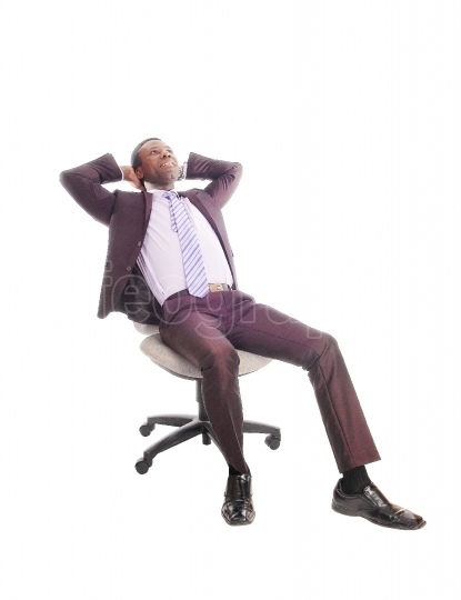 African business man relaxing on chair