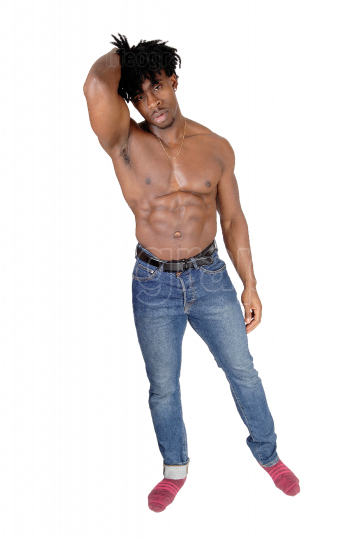 African man flexing his biceps and looking into the camera