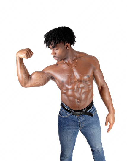African man flexing his biceps and looking on it