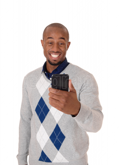 African man looking happy at his cellphone