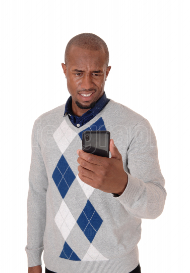 African man looking puzzled at his cellphone