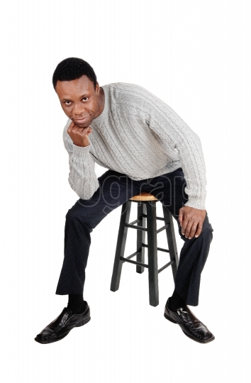 African man sitting on chair and thinking