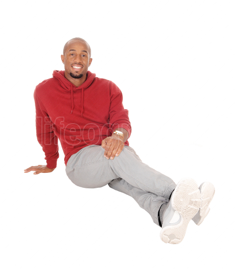 African man sitting on floor resting